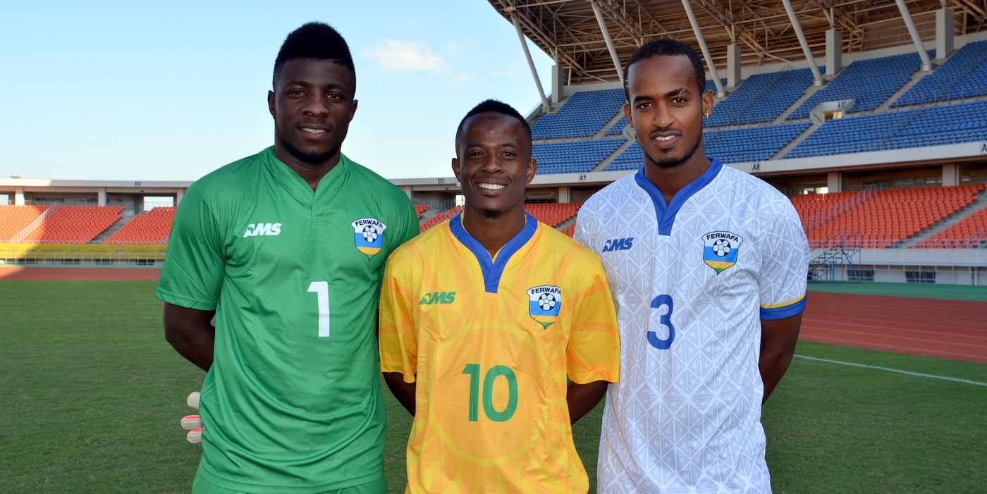 L-R: Olivier Kwizera (Goalkeeper);  Haruna Niyonzima (Captain); Yannick Mukunzi - modelling the new Rwanda Amavubi Kit by AMS  [new goalkeeping; home and away kits by AMS are pictured at training camp ahead of Rwanda Amavubi v Mozambique, 13 June 2015  (Pic © Darren McKinstry / www.johnnymckinstry.com)]